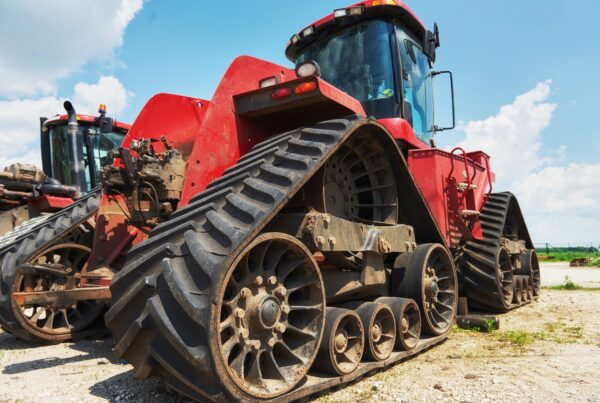 Harvesters and combine parts at the plant are waiting for sales, tractors and agricultural machinery